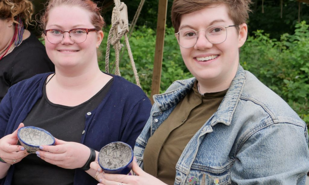 2 proud people with their successful pots