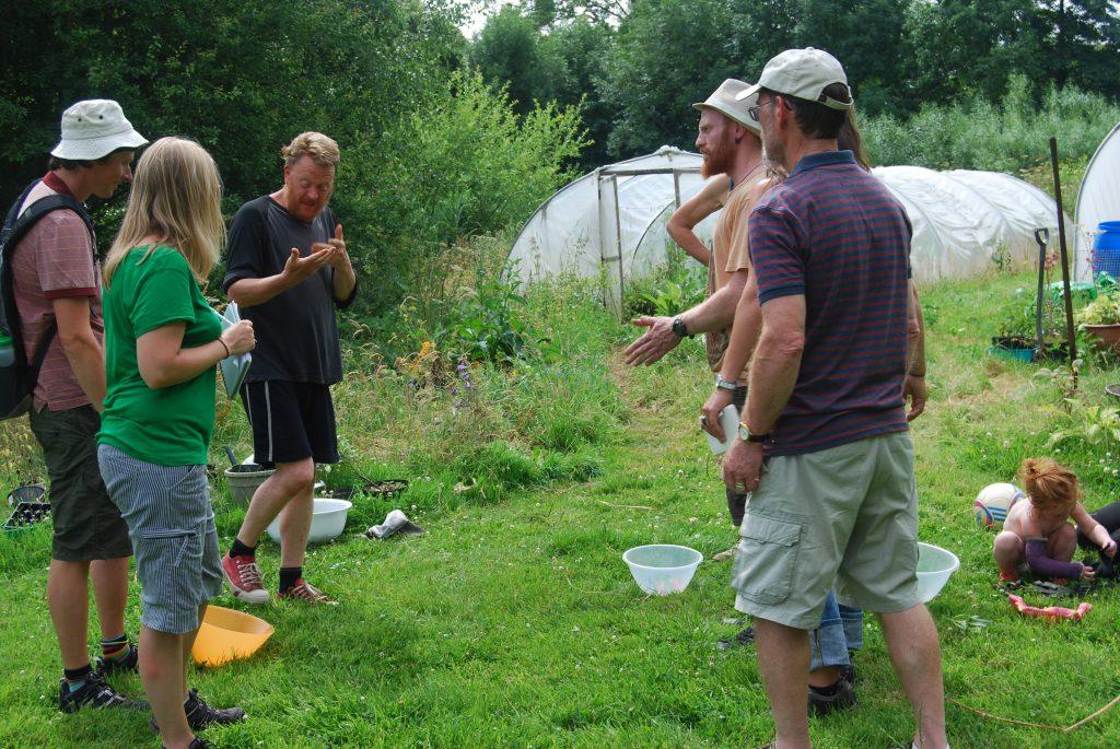 Stu talking to group in garden