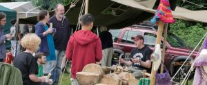 Mike giving his green woodwork workshop to smiling people drining tea at radical bakers