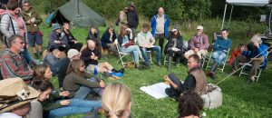 ed revill giving his talk on biochar and soil carbon to an audience of 30 people in a field