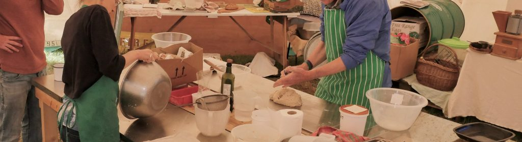 People baking in a marquee on catering surfaces at radical bakers 2018