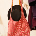 patterned bag and black hat