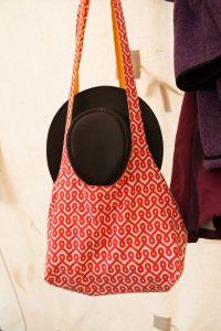 patterned bag and black hat