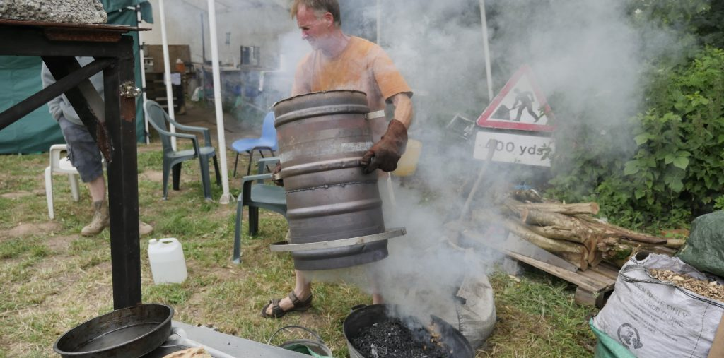ed revill stoking his biochar gasification stove